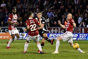 Kyle Magennis slots home St Mirren's second goal in added time to seal their 2-0 victory over Hamilton in Paisley last night. Picture: SNS