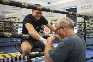 World-renowned trainer Freddie Roach tapes up the right hand of Ivan Baranchyk as the Belarusian prepares to face Josh Taylor. Picture: SNS