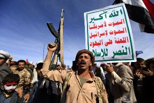"TOPSHOT - Supporters of Yemen's Huthi rebels attend a rally marking the fourth anniversary of the Saudi-led coalition's intervention in Yemen, in the capital Sanaa on March 26, 2019. - A Saudi-led military coalition entered Yemen in March 2015 with the goal of restoring its ""legitimate"" government to power after the Huthis and their allies took over Sanaa. (Photo by MOHAMMED HUWAIS / AFP)        (Photo credit should read MOHAMMED HUWAIS/AFP/Getty Images)"