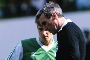George Smith books Hibs striker Gareth Evans during a Scottish Cup semi-final at Hampden in 1989