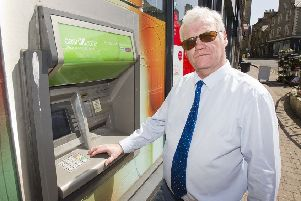 Councillor Davie Paterson at the cashpoint outside Hawick's Sandbed Post Office.