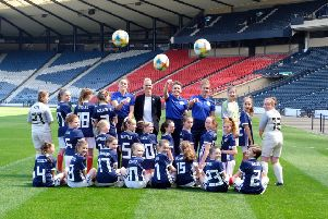 Scotland's Lee Alexander, manager Shelley Kerr, Joanne Love and Nicola Docherty with young fans at Hampden Park. Picture: Lorraine Hill