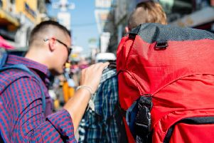 Encounters with visitors lugging giant backpacks are an occupational hazard when catching the Number 35 bus. Picture: Getty