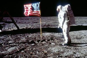 "060280 01: Astronaut Edwin ""Buzz"" Aldrin poses next to the U.S. flag July 20, 1969 on the moon during the Apollo 11 mission. (Photo by NASA/Liaison)"