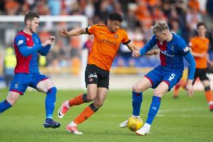Osman Sow takes on Inverness defender Coll Donaldson during Dundee United's 1-0 victory in the first leg of their play-off semi-final at the Caledonian Stadium on Tuesday. Picture: SNS