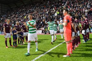 The Hearts players give the champions Celtic a guard of honour as they walk out onto the pitch at Tynecastle last season. Picture: SNS