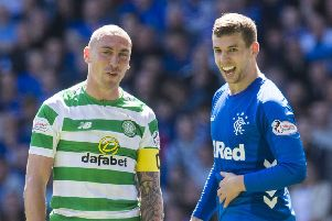 Jon Flanagan (right) shares a joke with Celtic's Scott Brown during the Old Firm clash. Picture: SNS Group