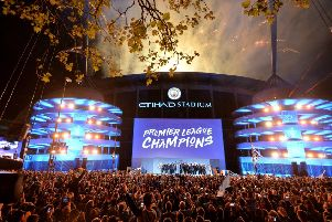 Champagne days at the Etihad Stadium ' but some fans who remember the lower division years still fear their superstar team is capable of imploding. Picture: PA.