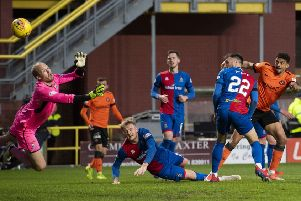 Osman Sow, far right, watches his shot on the turn fly past goalkeeper Mark Ridgers to give Dundee United a two-goal lead. Picture: SNS.