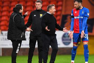Inverness boss John robertson discusses the penalty incident with Brad McKay, while assistant manager Scott Kellacher speaks to fourth official David Lowe. Picture: Alan Harvey/SNS