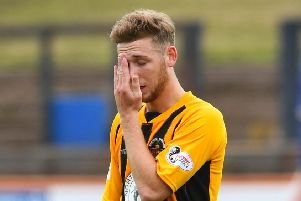 Dejection for 'Berwick's Jack Ogilvie is dejected after the first goal. Picture: SNS.