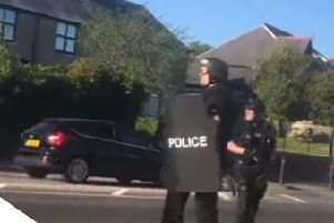 Armed police officers on the scene in Bathgate. Picture: Youtube.