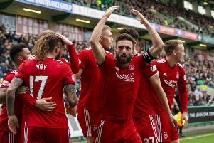 Aberdeen's Graeme Shinnie celebrates James Wilson's goal. Pic: SNS/Ross Parker