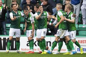 Hibernian's Marc McNulty celebrates his goal with his teammates. Pic: SNS