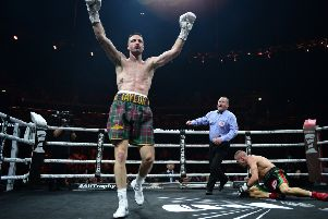 Josh Taylor reacts as he knocks down Ivan Baranchyk in the sixth round in Glasgow. Picture: Getty.