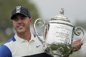 Brooks Koepka holds up the Wanamaker Trophy after winning the US PGA Championship at Bethpage Black. Picture: AP