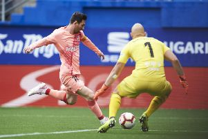 Lionel Messi scoring against Eibar on Sunday. Picture: Getty