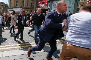 Nigel Farage has what appears to be milkshake thrown on him in Newcastle (Picture: Ian Forsyth/Getty Images)