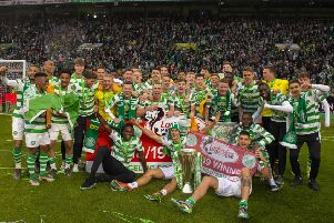 Celtic's players celebrate with the Ladbrokes Premiership trophy - but is the squad too big? Picture: SNS