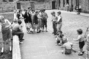 A long and well-established right: children playing peevers in Lapicide Place in Leith in 1957