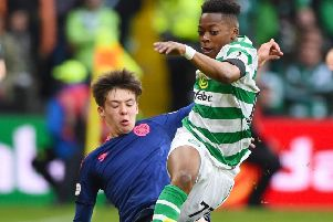 Celtic's Karamoko Dembele is tackled by Hearts' Aaron Hickey. Picture: SNS