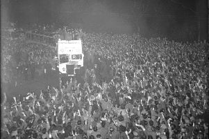 Hearts parade the 1956 Scottish Cup on an open-top bus in Edinburgh. Picture: TSPL