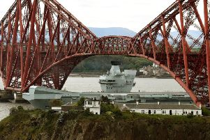 HMS Queen Elizabeth leaving the Firth of Forth. Picture: TSPL