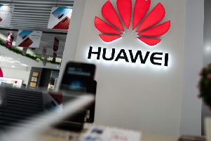 Huawei is a world leader in 5G technology but concerns remain over the potential for spying by China (Picture: Fred Dufour/AFP/Getty Images)