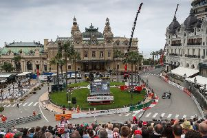 Lewis Hamilton steers his car around the square in front of the Monte Carlo Casino during first practice for the Monaco Grand Prix. Picture: PA.
