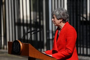 Theresa May stands outside 10 Downing Street. Picture: PA