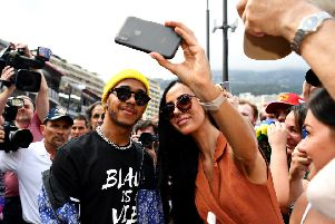 Lewis Hamilton poses for a selfie with a fan in Monte Carlo. Picture: Michael Regan/Getty