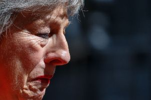 Theresa May loses her composure after announcing her resignation. Picture: Tolga Akmen/AFP/Getty Images