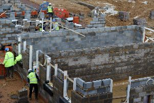 The work of Scots builders continues amid the political chaos. Picture: Andrew Matthews/PA