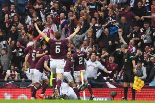 Hearts' players celebrate Ryan Edwards' opener with the fans. Pic: SNS/Craig Williamson