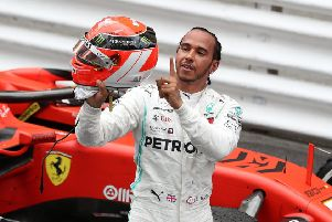 Lewis Hamilton points to Niki Lauda's name on the back of his helmet after claiming victory in the Monaco Grand Prix. Picture: David Davies/PA