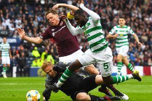 Odsonne Edouard is fouled in the box by Hearts goalkeeper Zdenek Zlamal, winning and then converting the penalty that drew Celtic level. Picture: Craig Foy/SNS
