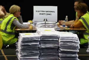 Ballot papers sit in a pile after being counted during the European Parliamentary elections count at the EICC. Picture: PA