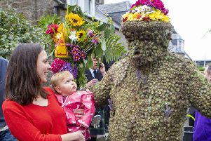 One-year-old Edith McQuatt and her mum Laura meet the Burryman as he takes to the streets of South Queensferry as part of the annual ritual.