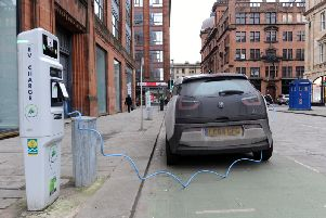 A safety charity has warned that a lack of public charging points for electric vehicles in Scotland is resulting in owners taking unnecessary risks with makeshift cabling
