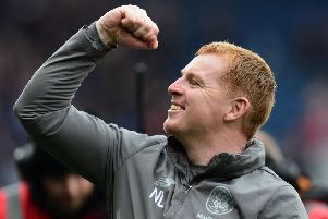 Neil Lennon celebrates clinching the treble treble, but next season he is likely to alter the focus of Celtic's play. Picture: Getty.