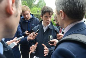 Rory Stewart is waylaid by reporters on his walkabout in Edinburgh. Picture: Jon Savage