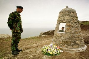 A cairn stands at the crash site, marked with the names of the passengers and crew who died