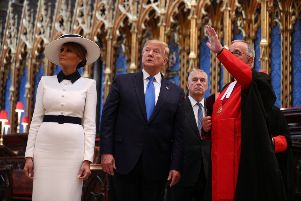 US President Donald Trump, accompanied by his wife Melania and the Duke of York, places a wreath on the Grave of the Unknown Warrior during a tour of Westminster Abbey in central London, on day one of his state visit to the UK. PRESS ASSOCIATION Photo. Picture date: Monday June 3, 2019. See PA story ROYAL Trump. Photo credit should read: Stefan Rousseau/PA Wire