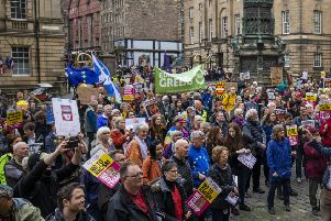 Hundreds of people protest against Donald Trump's State visit outside St Giles Cathedral in Edinburgh.  Picture: Duncan McGlynn
