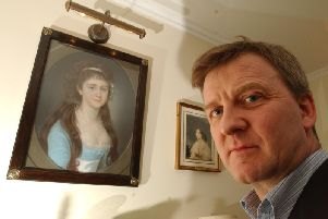 Peter Pininski pictured in 2002 with a painting of Marie-Victoire, Princess de Rohan, Bonnie Prince Charlie's granddaughter. Picture: Phil Wilkinson/TSPL