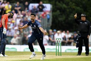 Scotland's Safyaan Sharif celebrates as Scotland beat England by six runs. Picture: Rob Casey/SNS