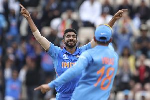 India's Jasprit Bumrah, left, celebrates with captain Virat Kohli after dismissing South Africa's Hashim Amla. Picture: Aijaz Rahi/AP