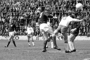 Colin Stein heads home one of his four goals in the 8-0 victory over Cyprus in 1969. Picture: TSPL.