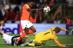 Quincy Promes shot deflects off England's Kyle Walker (left) and leads to the Netherlands' decisive second goal. Picture: PA.