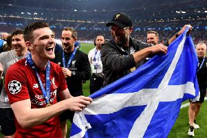 Andy Robertson parades the Saltire with manager Jurgen Klopp in Madrid after lifting the Champions League trophy with Liverpool. Picture: Andrew Powell/Liverpool FC via Getty